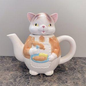 Cat eating dinner tea pot